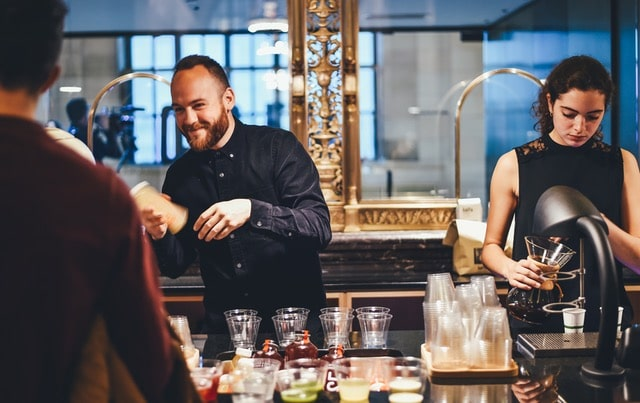 Photo of 2 bartenders