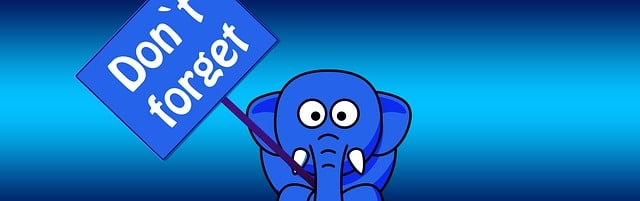 Elephant holding a sign saying Don't Forget