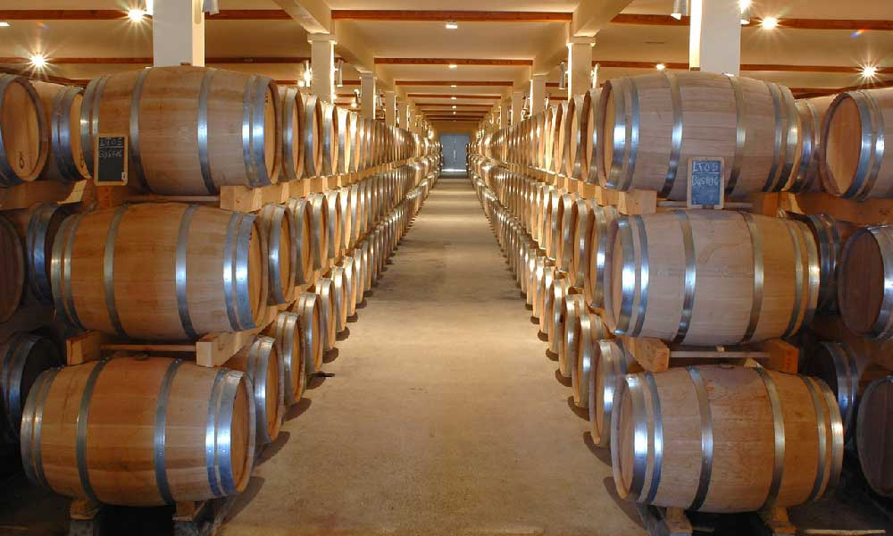 Beer barrels in a massive cellar